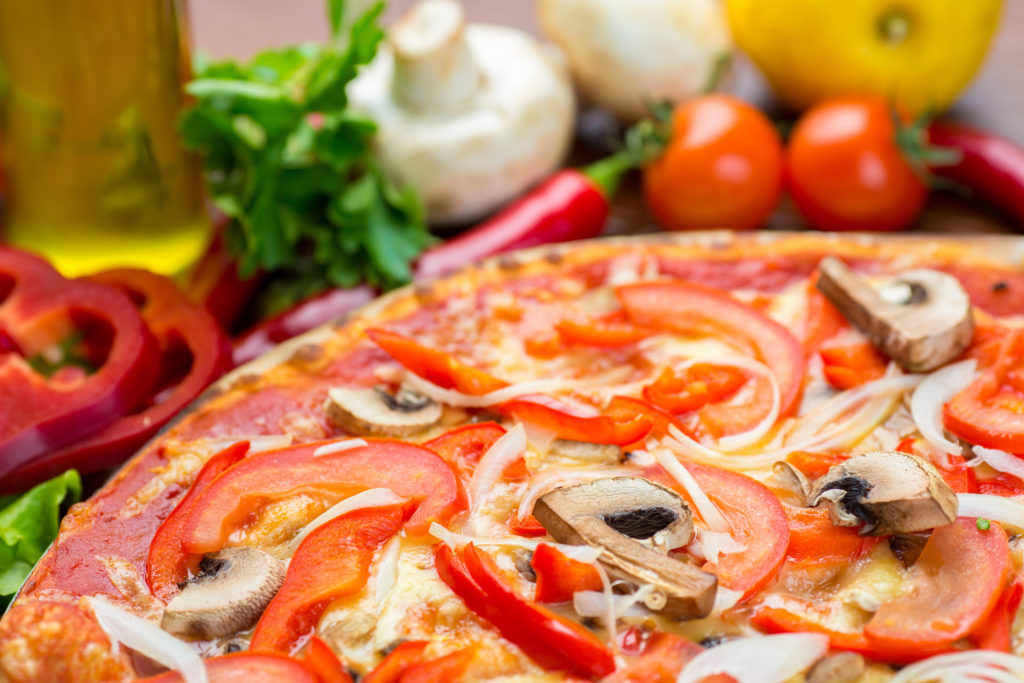 pizza with onion, pepper and mushrooms